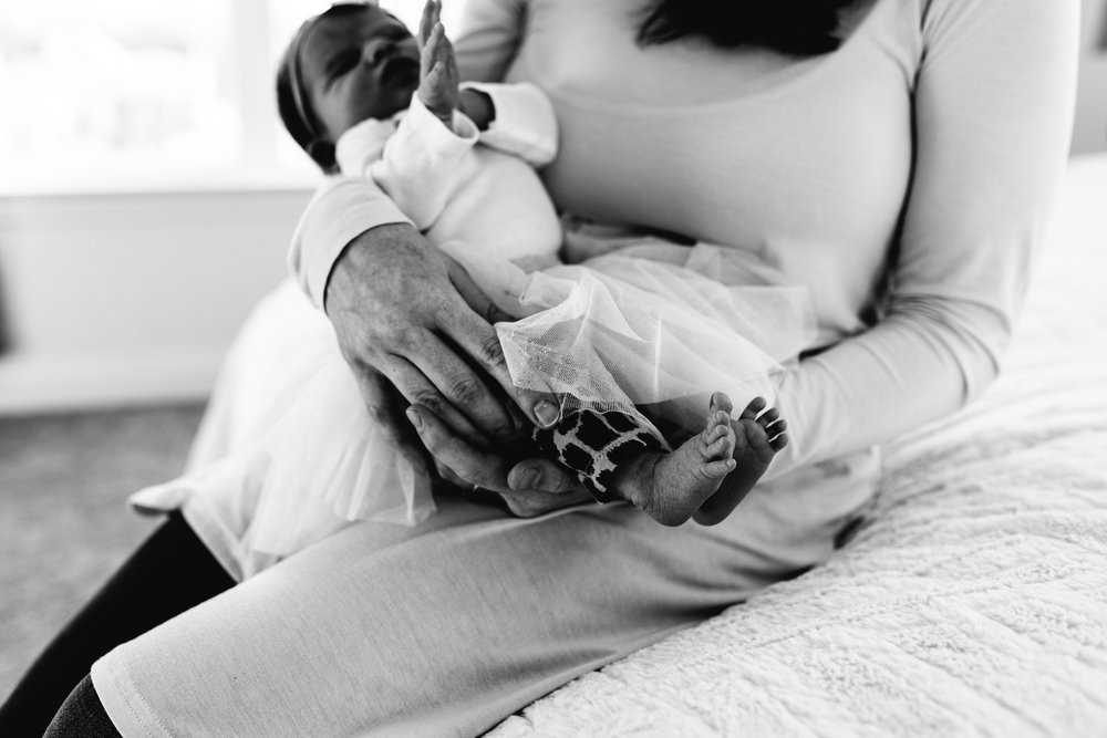 Mother-holding-newborn-daughter-Columbus-Ohio-Photographer-Erika-Venci-Photography