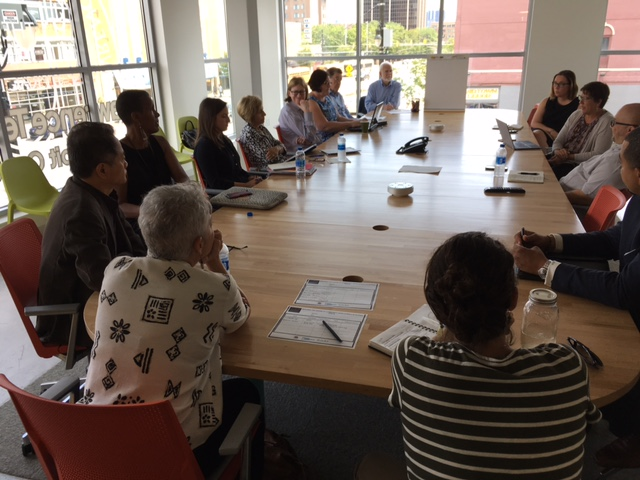 Members of the Career and Education Pathways, Research, Data and Evaluation and Certification and Capacity Building Planning Teams and consultants discussing the work that they have been doing for the past four months at the Stakeholder Information Exchange on July 27th