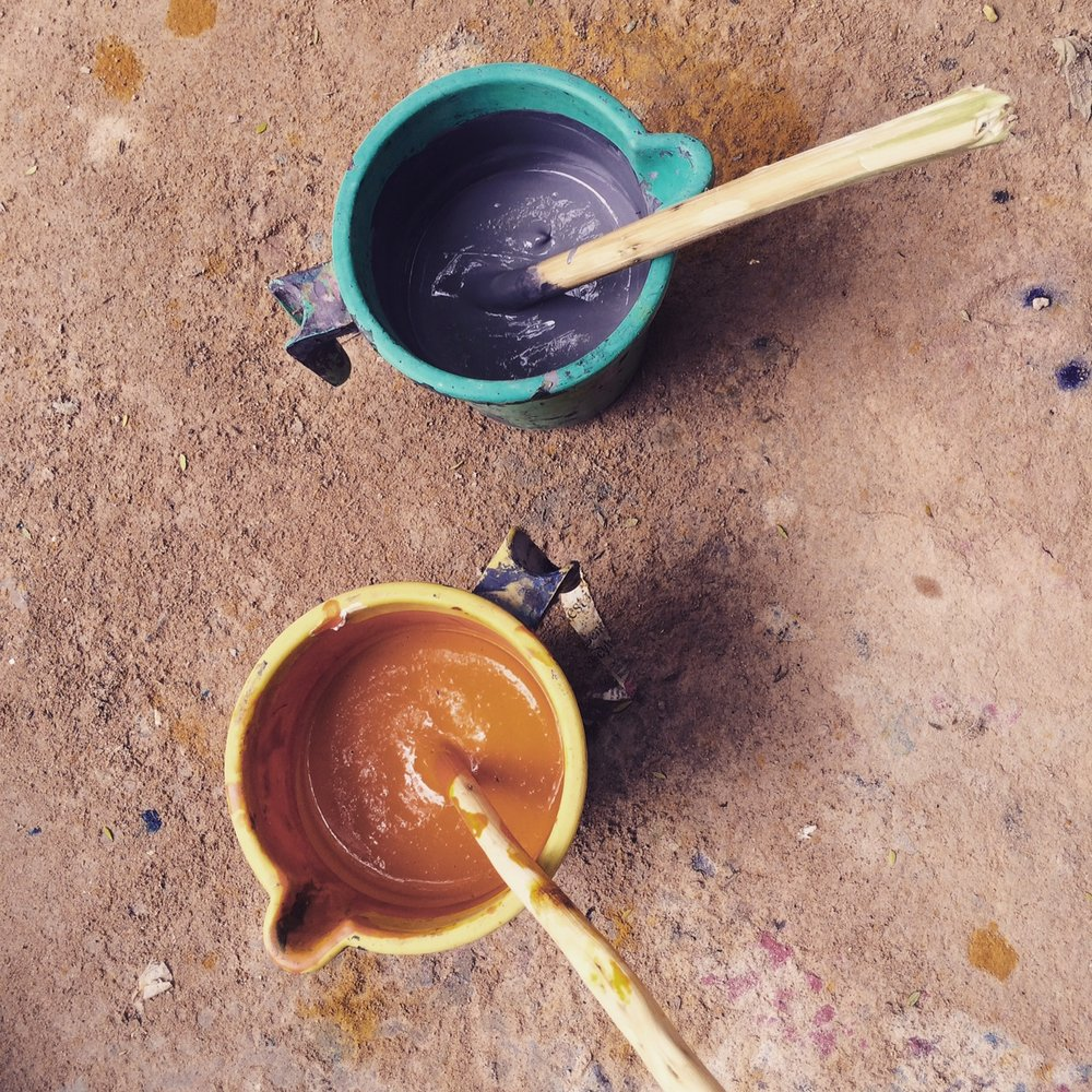 Pots of dye on the floor of the blockprint studio. The colors have been expertly matched with our 100% linen bedding range. The color will be stamped by hand onto our pillowcases by using a wooden block.