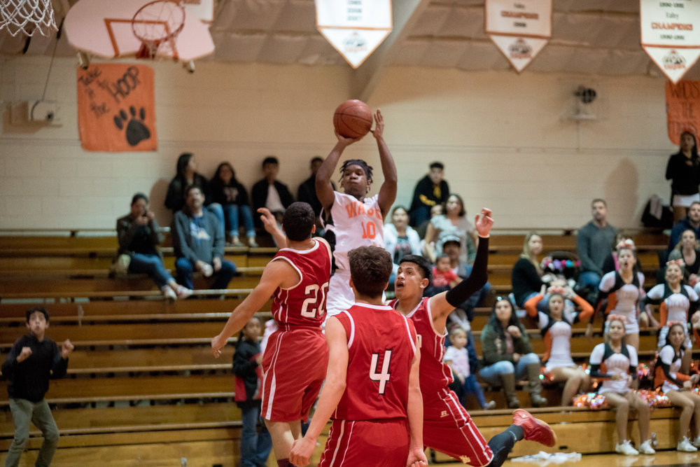With seconds to go, Dez'Mier Smith makes the game winning shot against Arvin.