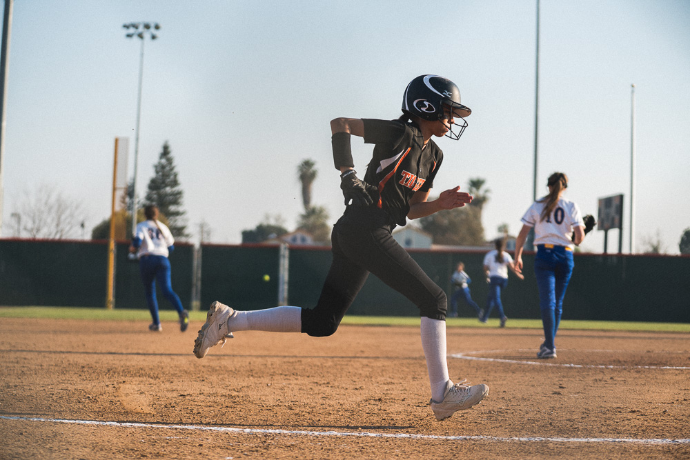 Eileen makes a run for 1st base during their tournament match against Mira Monte.