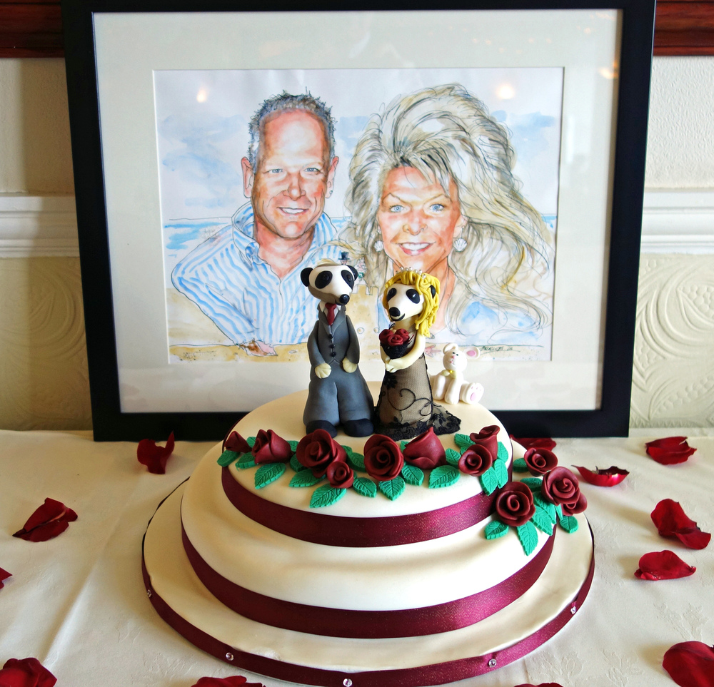 Happy couple and cake