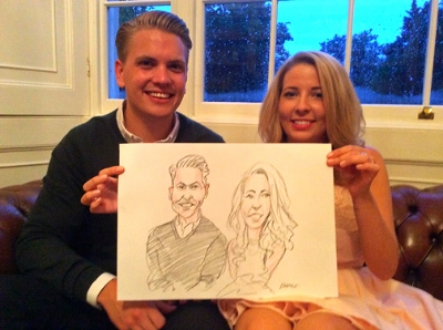 Happy couple with their wedding caricature