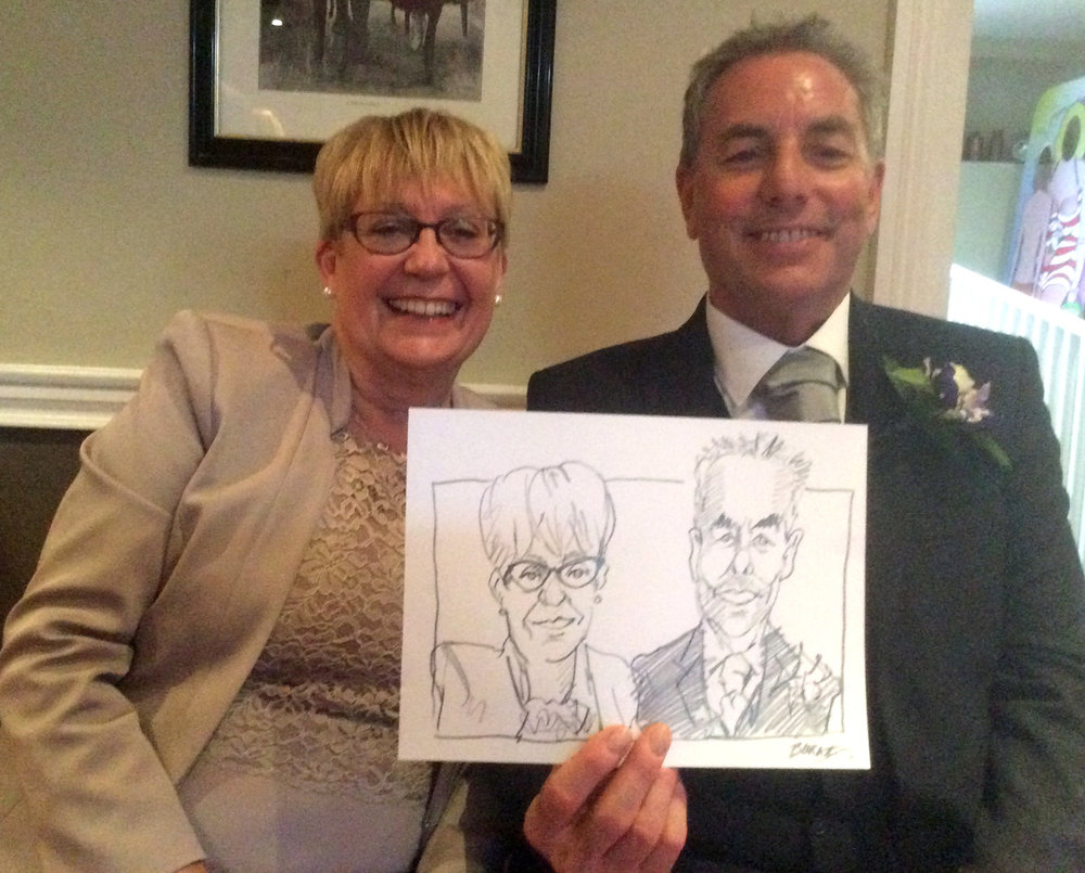 Mother and father of the Groom. Happy with thier portraits