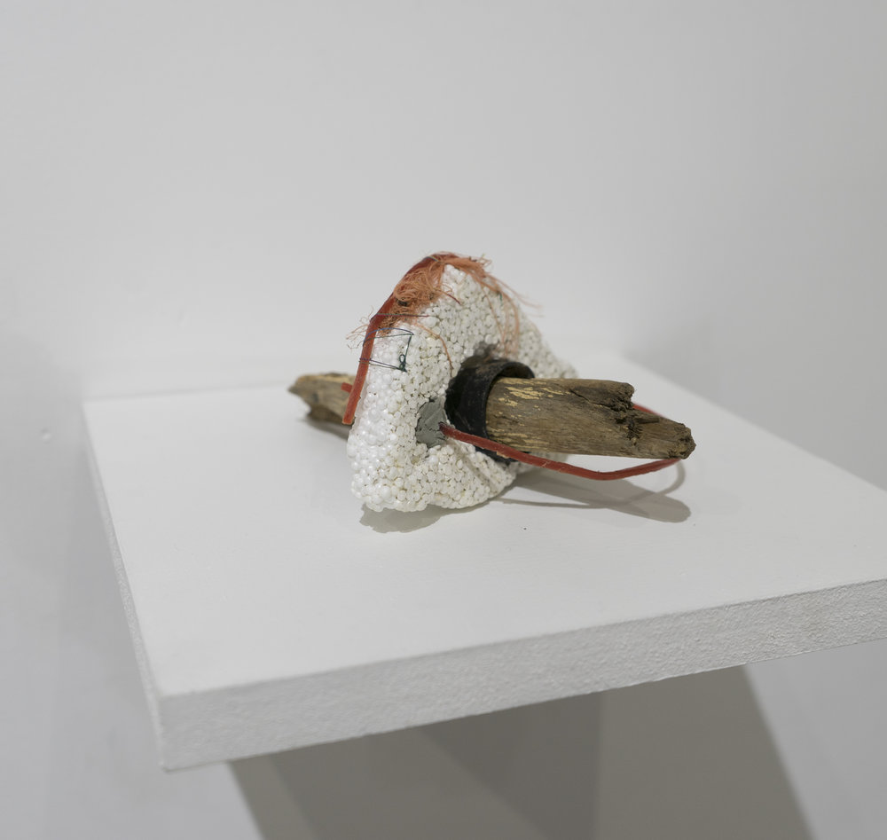hillface     Jessica Lund-Higgins   styrofoam, wood handle, clay, cathair, trimmer cord  2015
