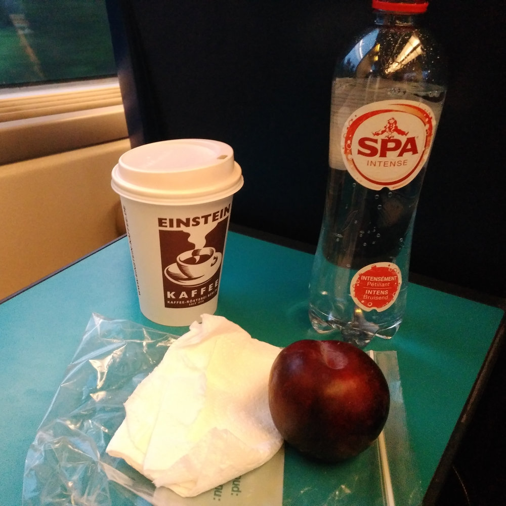 Took a piece of fruit from home and grabbed a soy latte and sparkling water at the train station. Ate most of it on the train to the Brussels Airport. It was a shockingly bad latte.