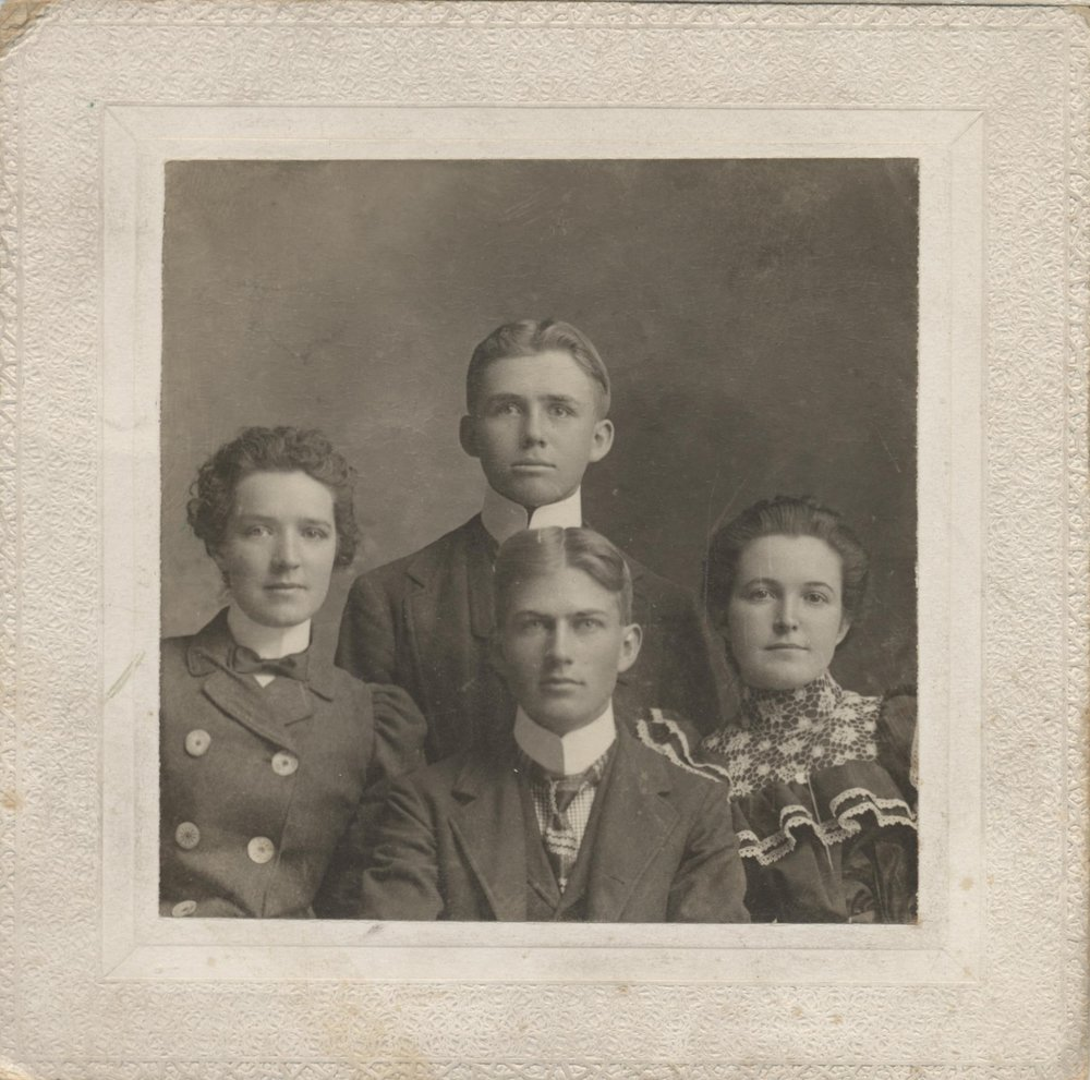William Edward Howard (center top) and three unidentified individuals, likely Stanton, Neb., c. 1894.