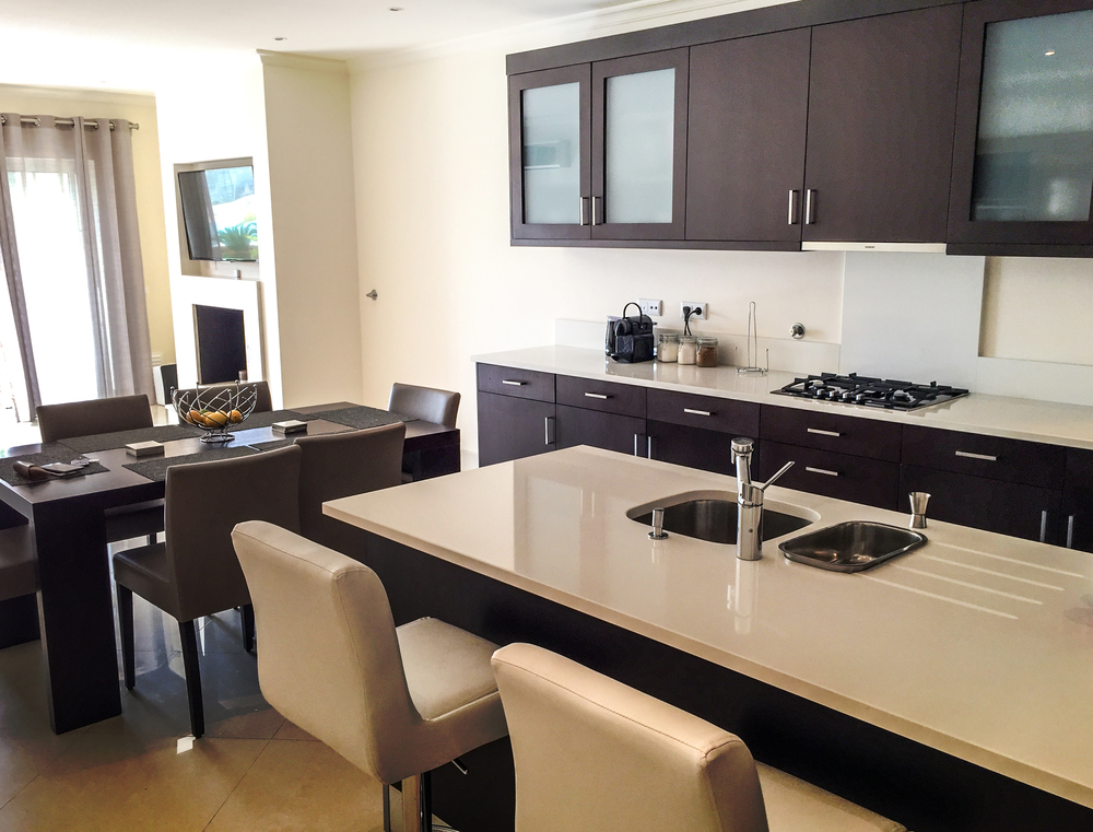 Kitchen area, with solid natural stone countertops and a feature island