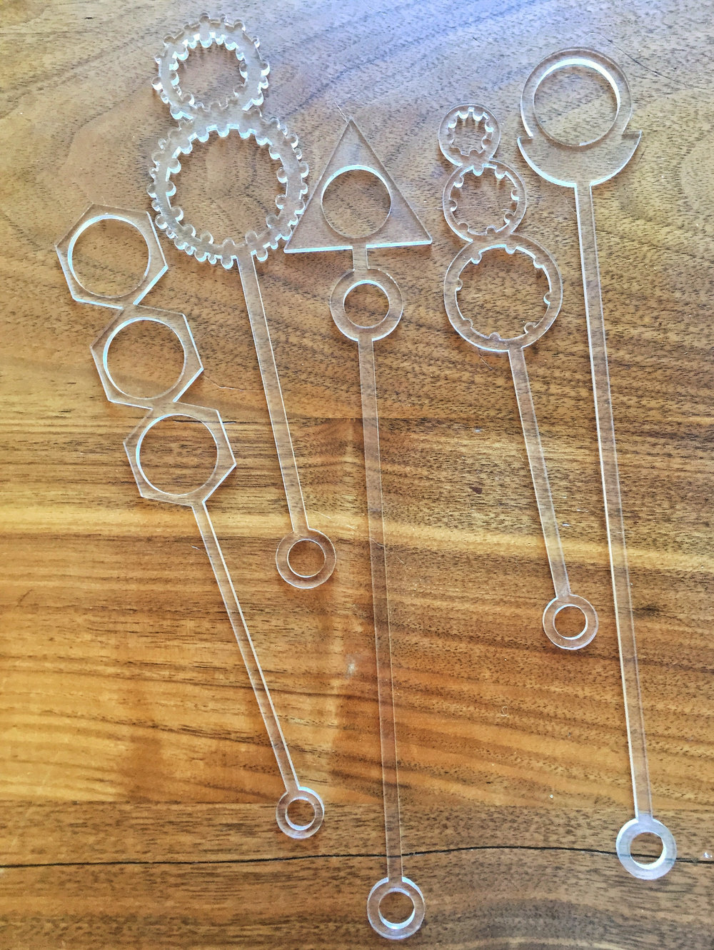 Bubble wands cut from clear acrylic