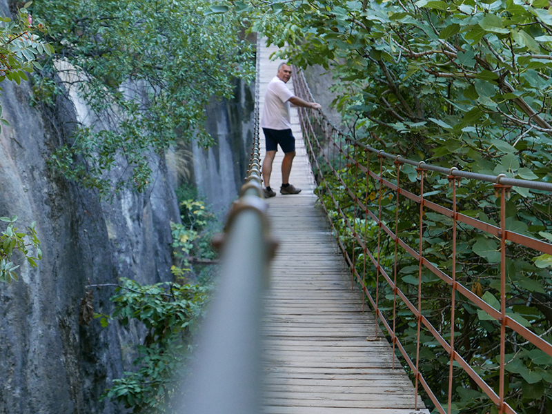 Ian tests the wobbly bridge first...