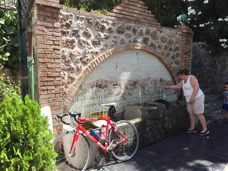 Me filling up at the Lanjaron water fountain (no, not really...I'm clad in lycra behind the camera)