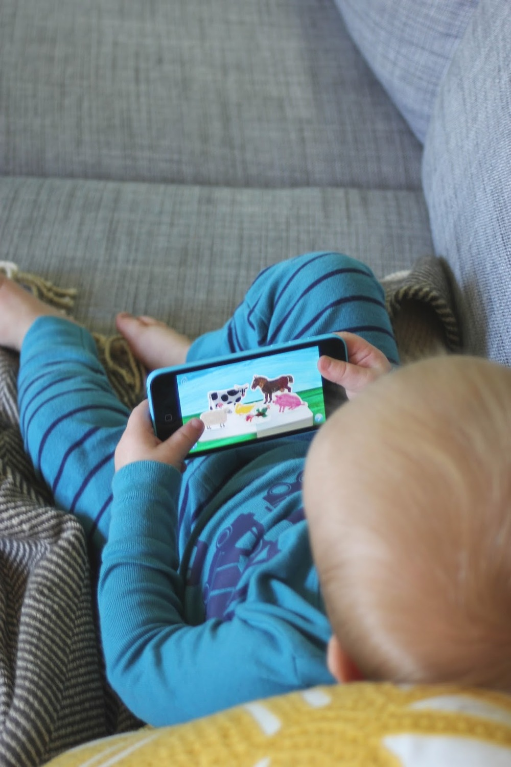 My son loves playing The Very Hungry Caterpillar First Words app and the others on this list...http://www.littlecityadventures.com/2015/10/educational-and-fun-apps-for-toddlers.html