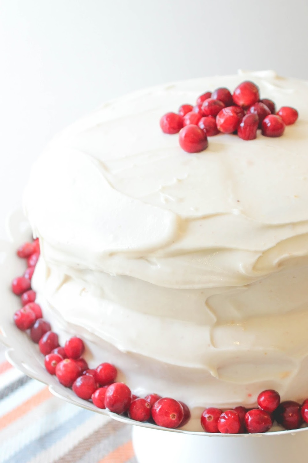 How beautiful is this Pumpkin Layer Cake with Cream Cheese Frosting?! And it's no ordinary cream cheese frosting, it's flavored with cranberry and orange zest. I don't think it gets much better than that. http://www.littlecityadventures.com/2015/11/recipe-pumpkin-layer-cake-with-cran.html #littlecitykitchen
