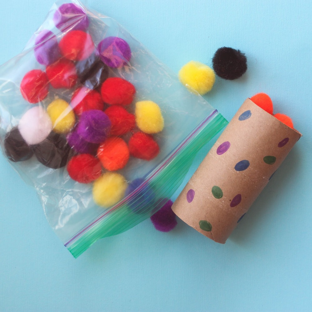 Learn how to make this simple and fun pom pom drop activity for your toddler http://www.littlecityadventures.com/2016/04/10-simple-and-fun-toddler-busy-bags.html