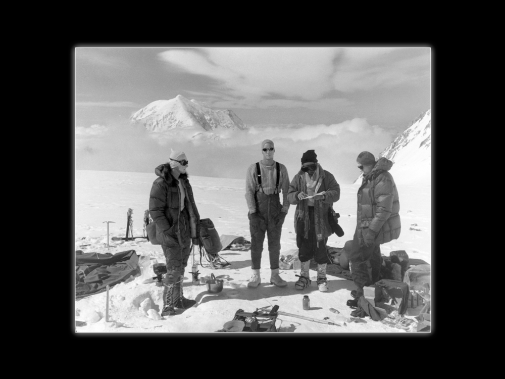 Camp below West Buttress at 14,500 feet, Mt. McKinley, 1960. (L to R) Jim, Lou, climber from a Japanese team, Pete Schoening.  John Day Photo