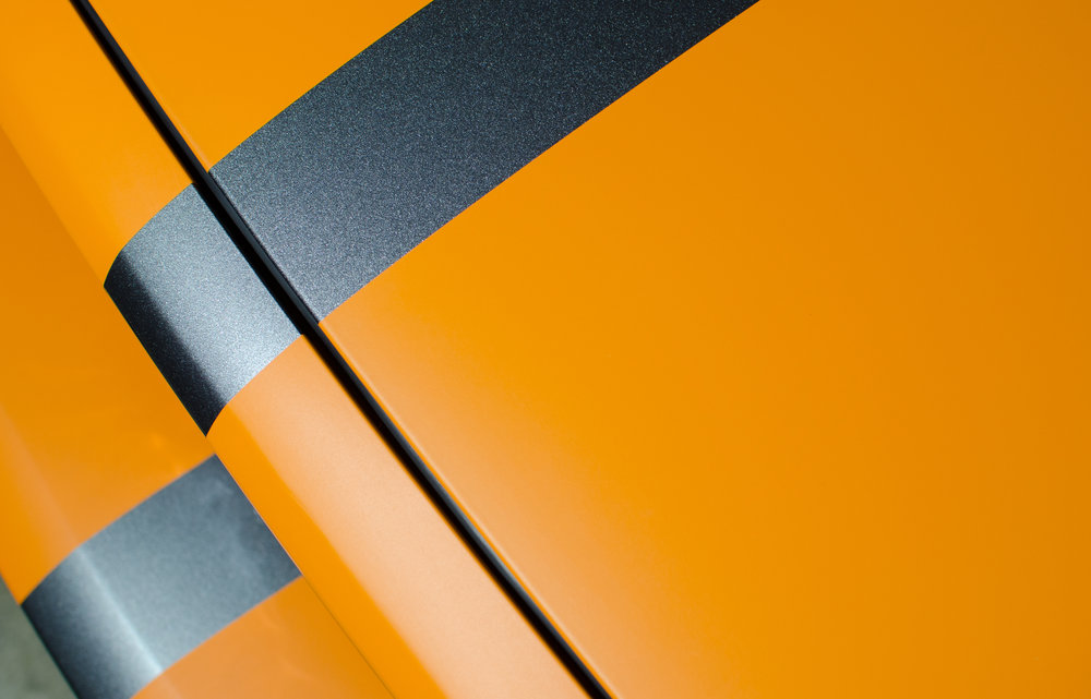 Avery Dennison SW900 Matte Orange Racing stripes on a 2014 ford mustang