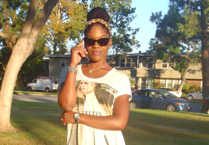 retro style, up the amp on dark skin, cat eye sunglasses, top knot, bun, natural hair