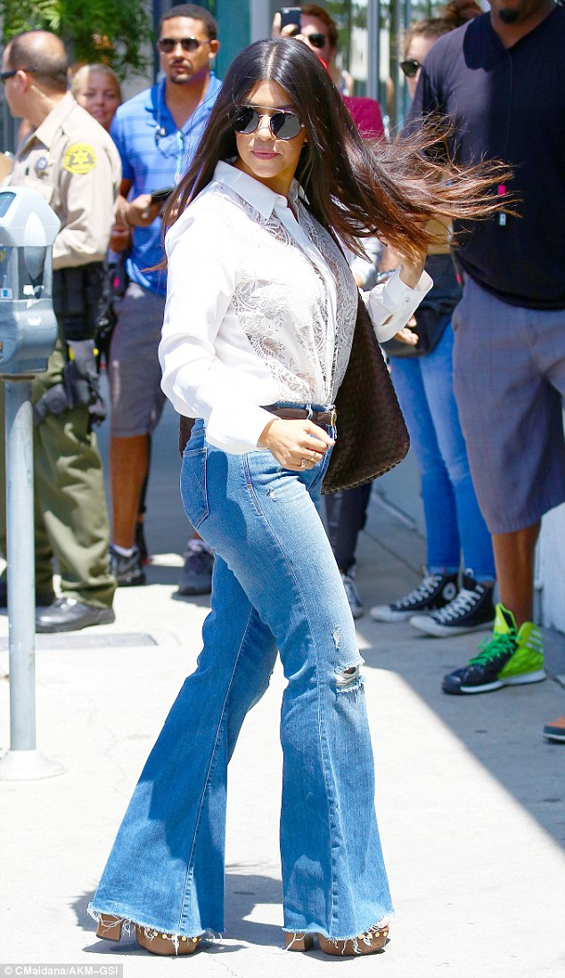 flare jeans - kourtney kardashian in front of dash store - dominic roux