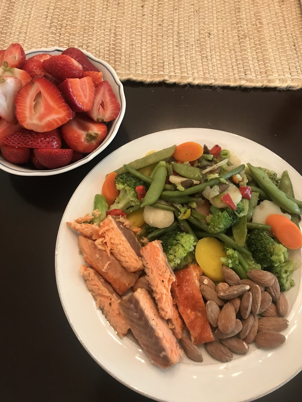 This is super simple.  4 ounces Smoked salmon.  40g almonds. 2 cups veggies. 3 cups strawberries. Little to no brain power needed. Salmon was bought smoked. Veggies were cooked in an oven in bulk. The entire meal is less than 600 calories and keeps my full for 4-5 hours minimum. This is following the RP simplified diet I posted earlier this week. When you eat like this 90% of the time, a hamburger and french fries with a cold beer is earth shaking. Work harder to find your balance. There is no excuse other than not trying hard enough.