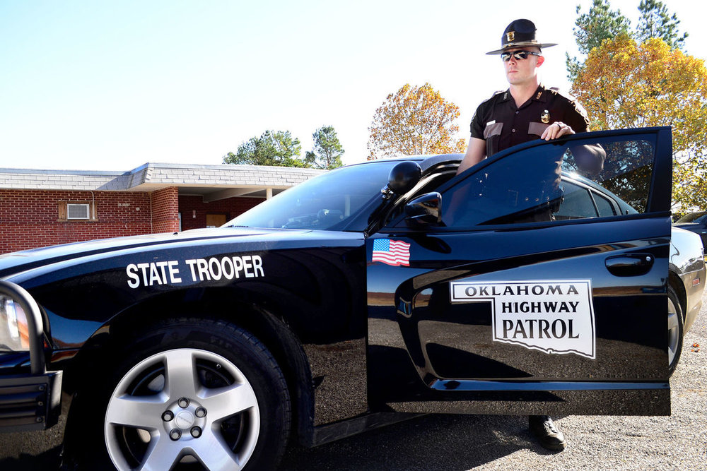 The Oklahoma Highway Patrol requires that applicants have completed a certain number of credits from an accredited college or university, so no written exam is required.