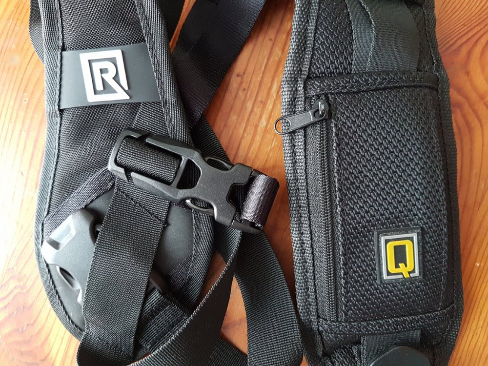 Black Rapid hybrid breathe camera strap on the left and cheap camera strap on the right