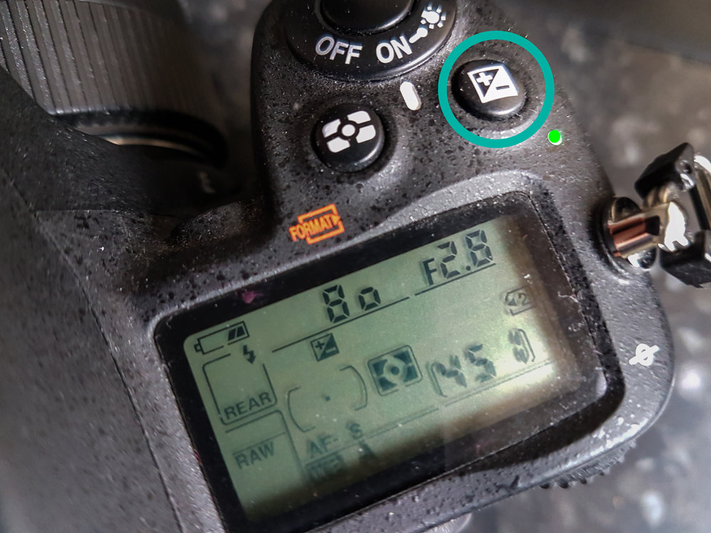 Exposure compensation button - Press and hold this button, then spin the rear command wheel, to change the exposure compensation in auto modes.