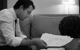 Attorney Ben Shipper reads through a case file at Deborah Gordon Law.  Kathleen Galligan