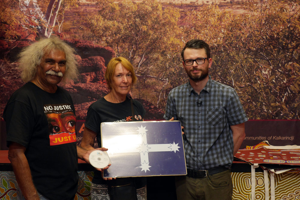 Presenting a new DVD of the Unlucky Australians to Maurie Jakarta Ryan and Penny Smith at Kalkarindji