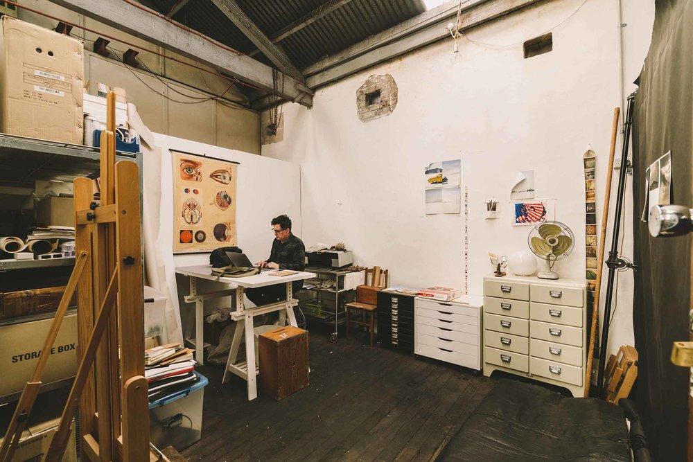 Internationally awarded photographer Michael Corridore working away in his studio at Nauti.jpg