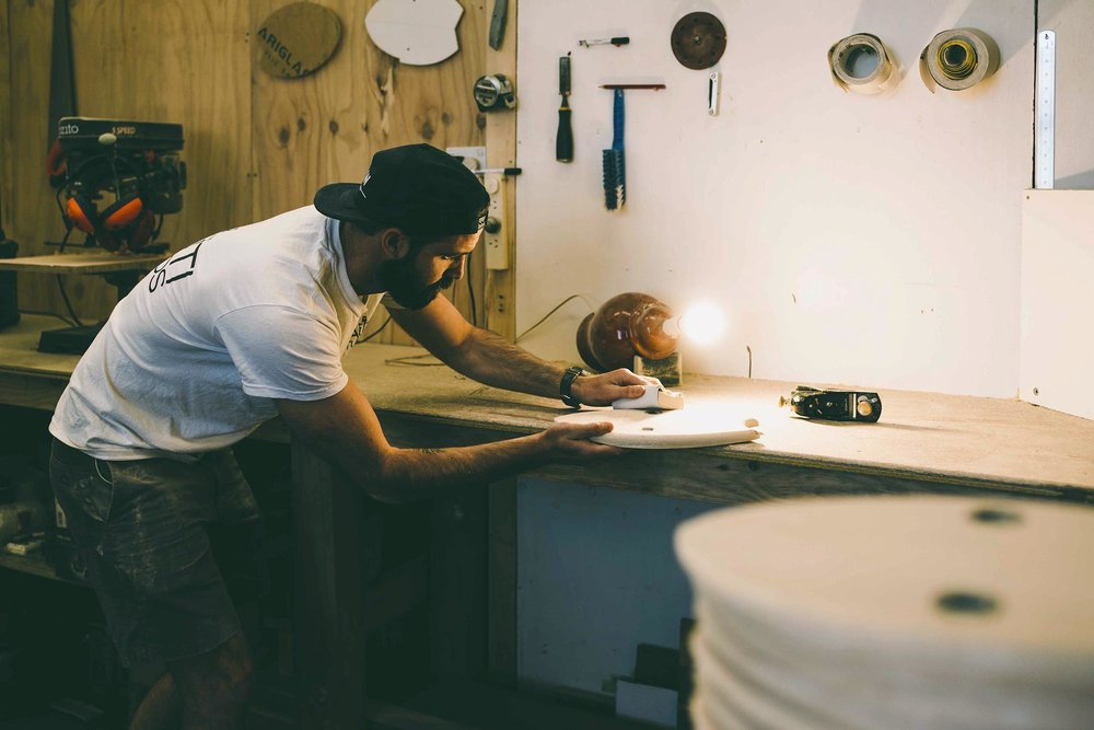 Rikki Gilbey of WAW Handplanes, forging his body surfing boards in his studio at Nauti Studios.jpg