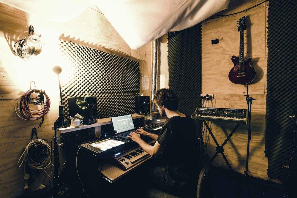 Sweet Potato crafting his dank beats in his music studio at Nauti Studios.jpg