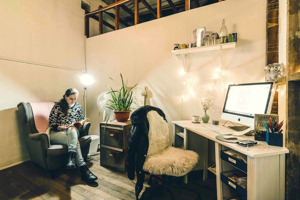 Writer, editor and content creator Kate working away in her office at night.