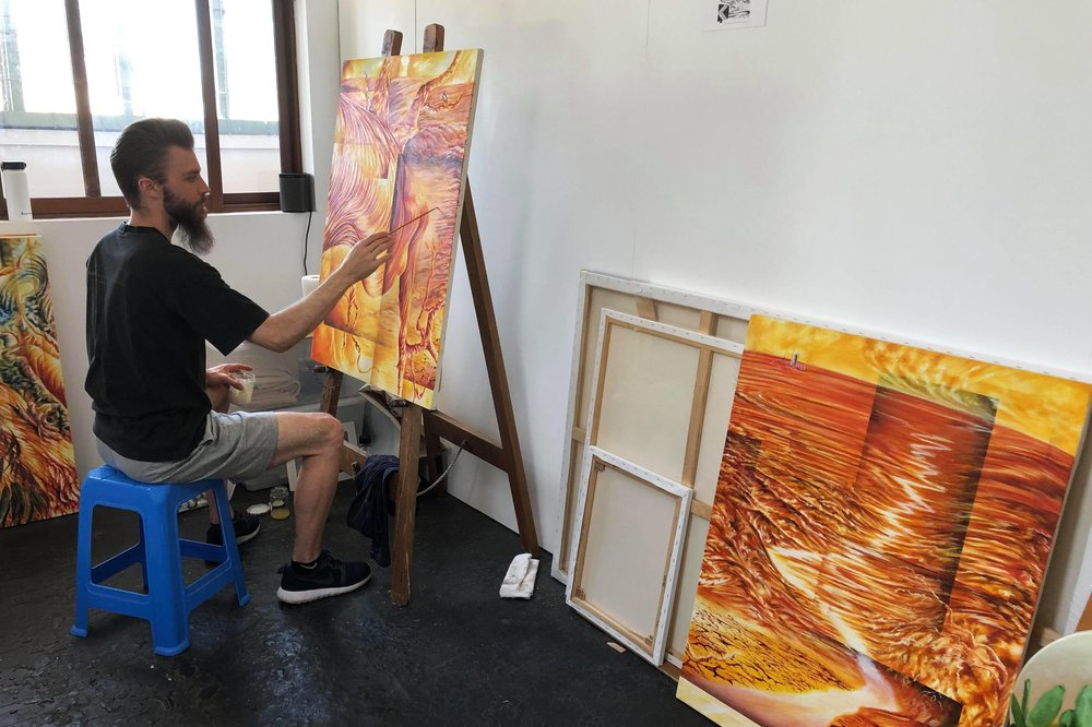 Daniel Baranovski, painter and photographer, working on his works for 'Snap Frozen & Still' in his studio at Nauti Studios, Blue Mountains.