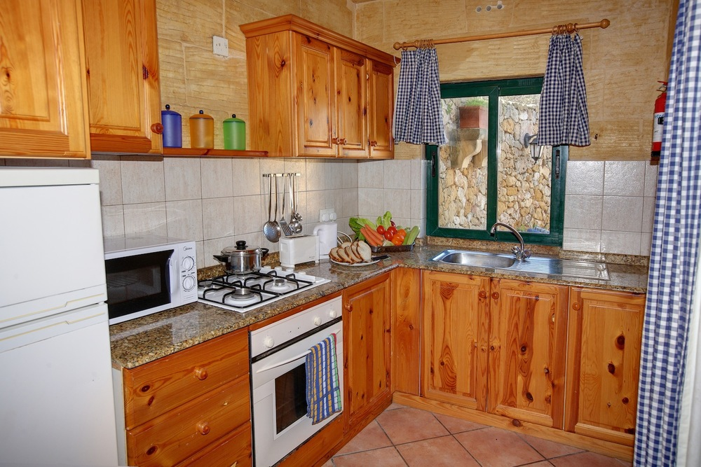 Fully equipped kitchen linking to pool terrace