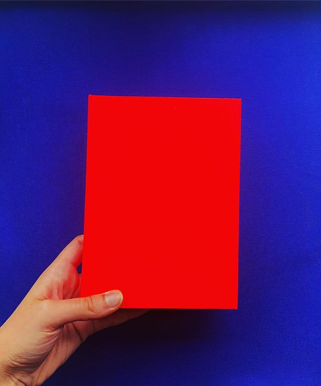 Making sketchbooks with @gfsmithpapers Electric Blood paper, so bright 😎