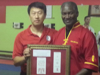 Receiving the Certifications from Grand Master Meng