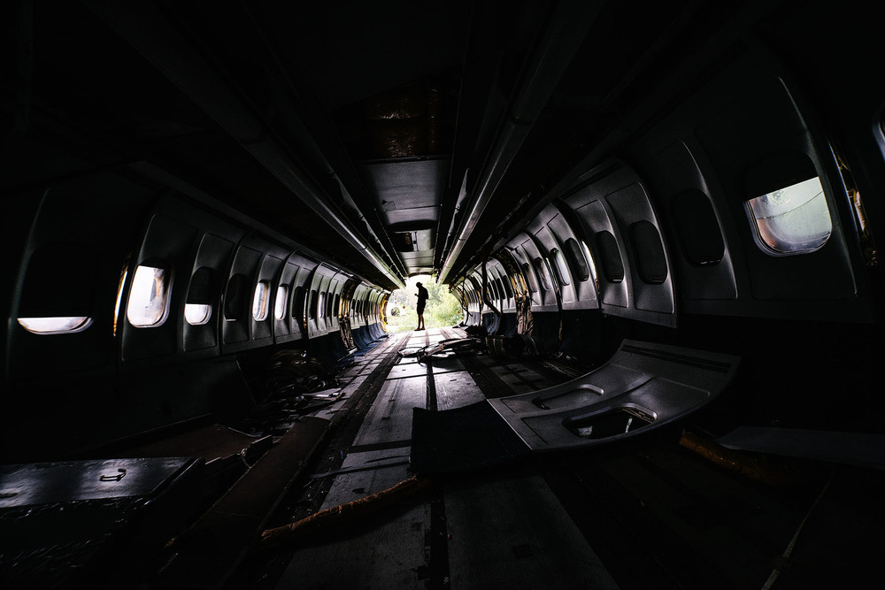 It is an eerie feeling walking in a forgotten plane with all the seats stripped out and the tail cut off.