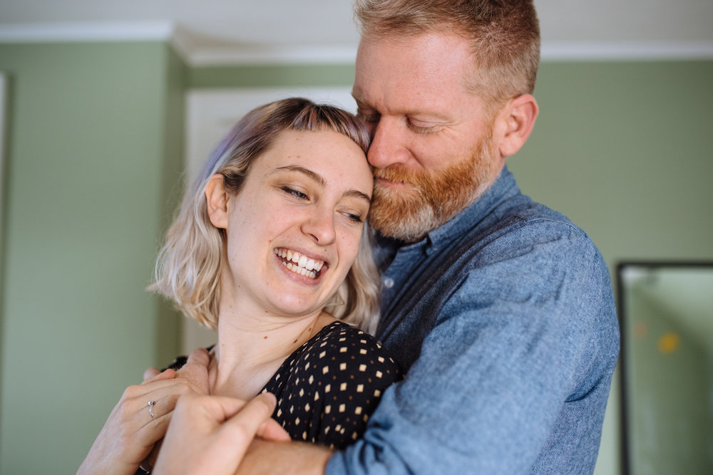 Couple-holding-woman-from-behind-bedroom-laughing-copyright-Elisabeth-Waller.jpg