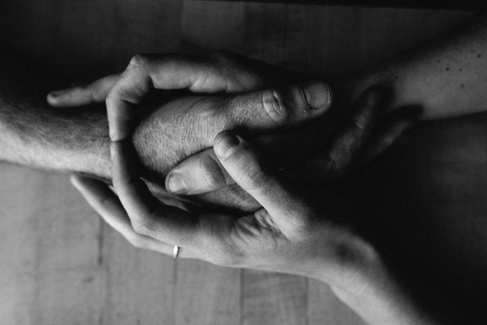 Couple-table-holding-hands-black-white-copyright-Elisabeth-Waller.jpg