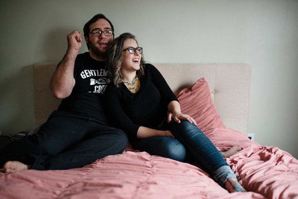 couple-laughing-on-bed-portrait-session-copyright-Elisabeth-Waller.jpg