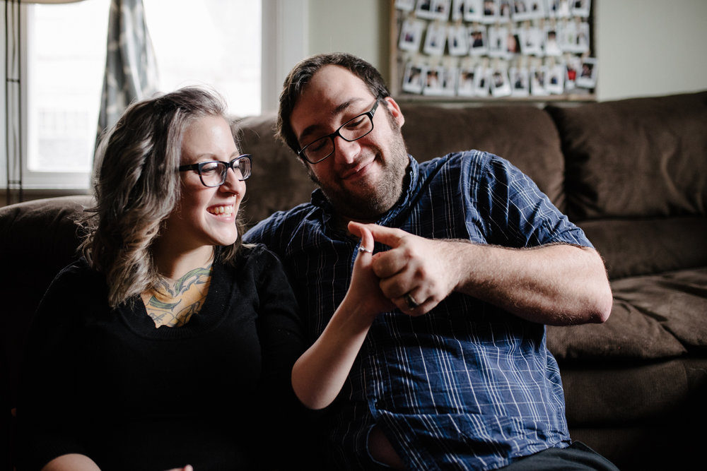 couple-playing-thumb-war-home-session-2-copyright-Elisabeth-Waller.jpg