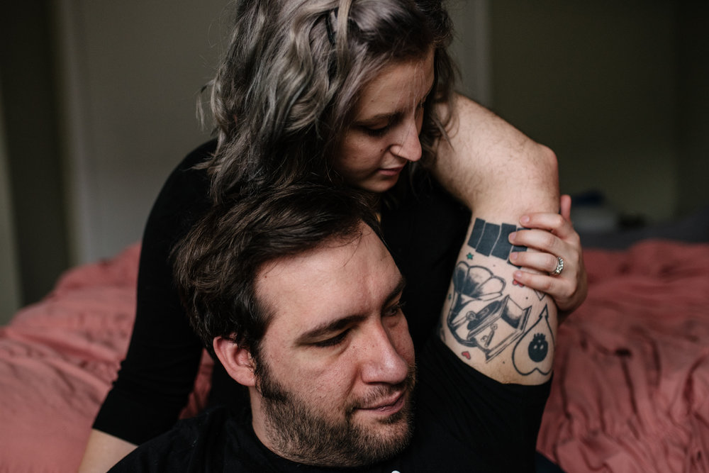 couple-together-woman-holding-arm-tattoo-copyright-Elisabeth-Waller.jpg