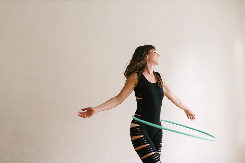 woman-with-hula-hoop-arms-outspread-©Copyright-Elisabeth-Waller.jpg