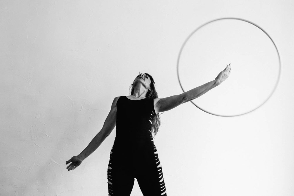 woman-with-hula-hoop-black-white-arm-through-©Copyright-Elisabeth-Waller.jpg
