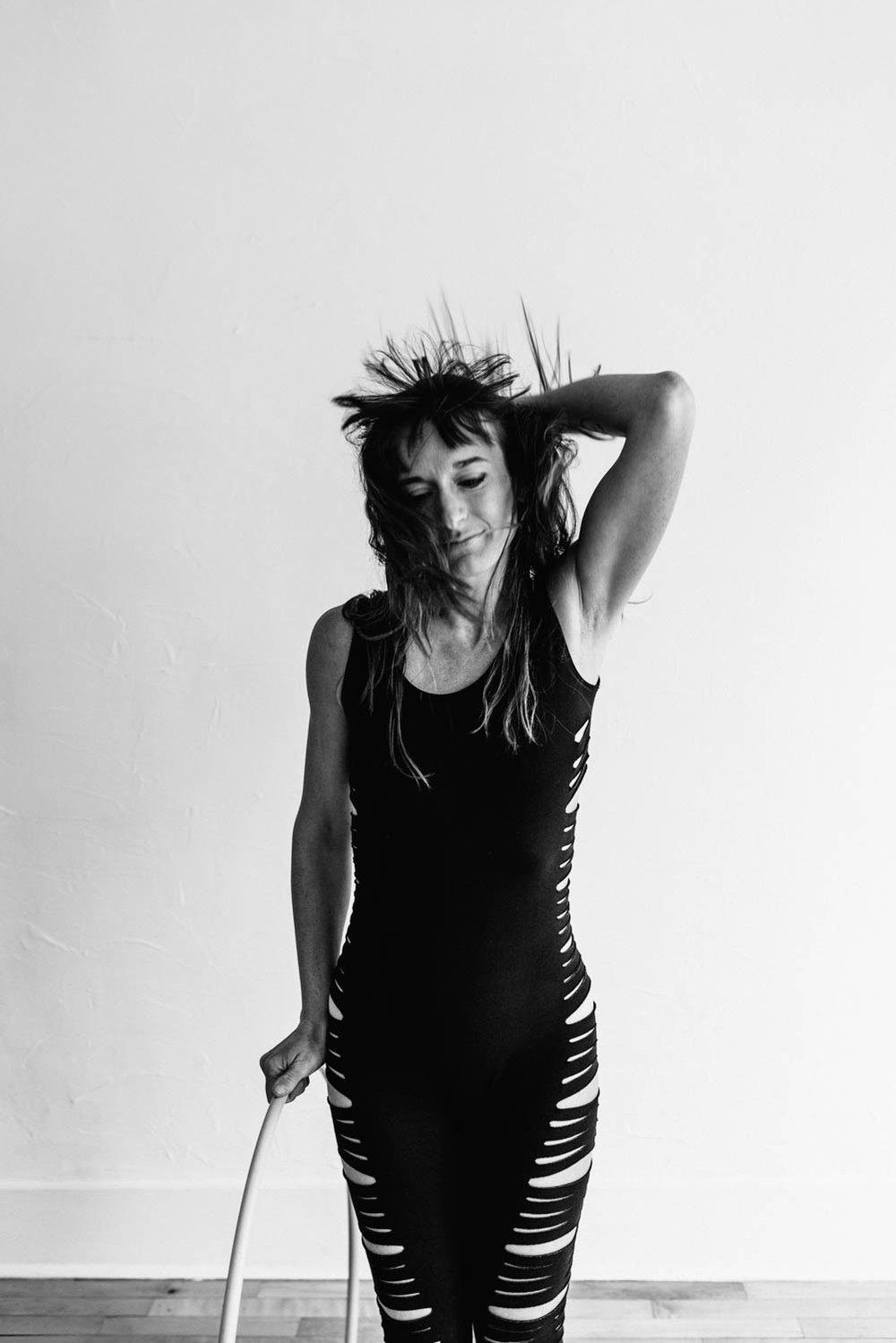 woman-with-hula-hoop-black-white-hair-flip-©Copyright-Elisabeth-Waller.jpg