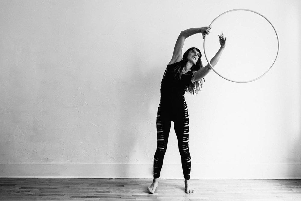 woman-with-hula-hoop-black-white-to-side-©Copyright-Elisabeth-Waller.jpg