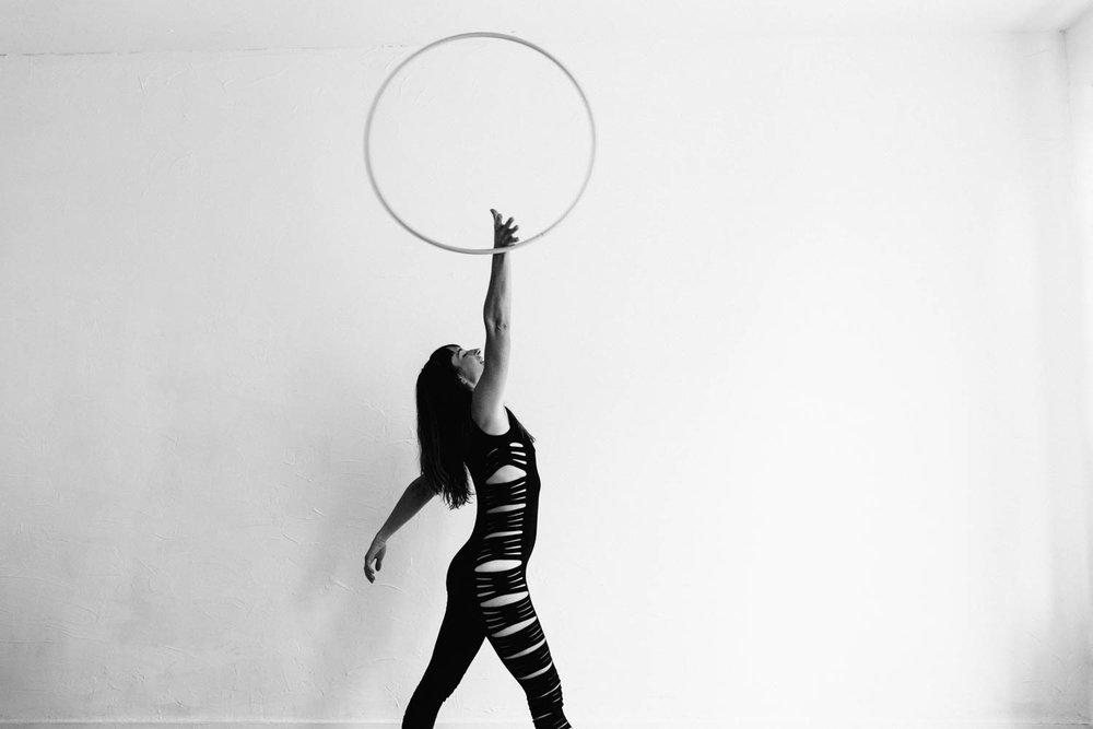 woman-with-hula-hoop-black-white-up-in-air©Copyright-Elisabeth-Waller.jpg