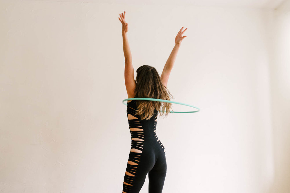 woman-with-hula-hoop-hands-in-air-©Copyright-Elisabeth-Waller.jpg