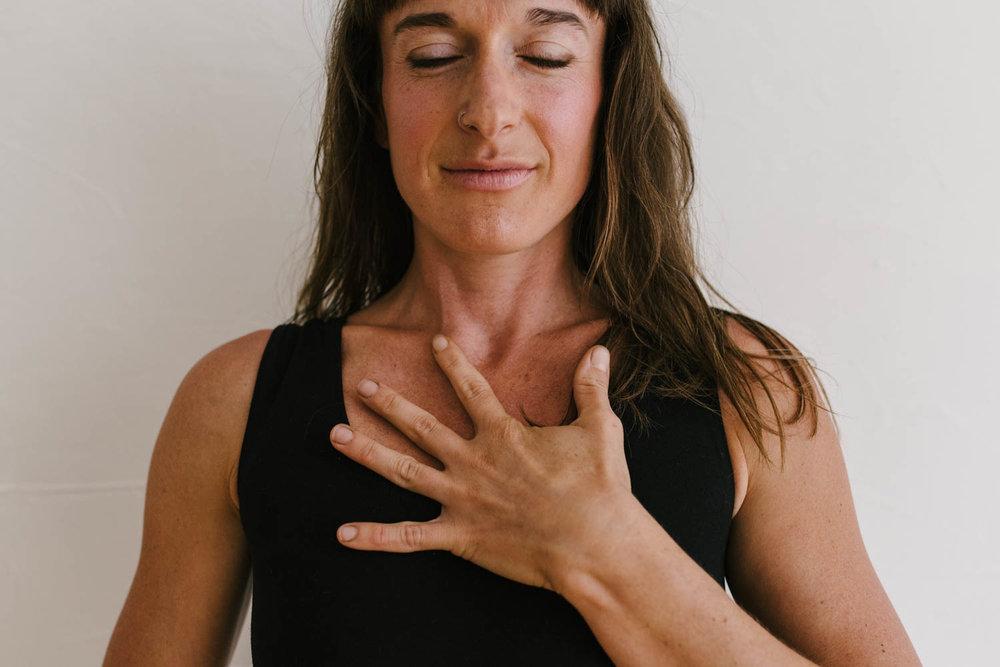 woman-yoga-hand-on-heart-©Copyright-Elisabeth-Waller.jpg