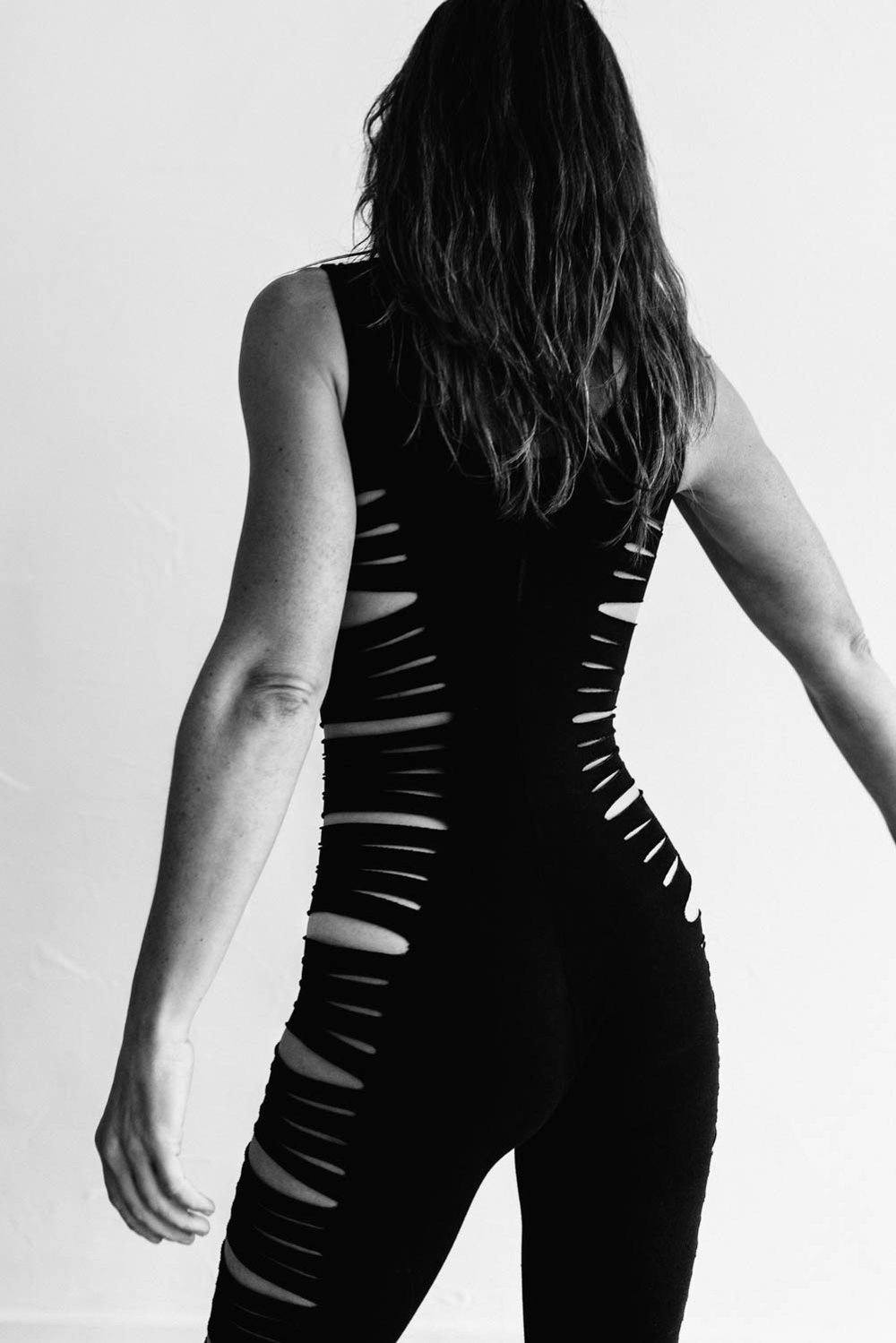 woman-yoga-pantsuit-from-behind-black-white-©Copyright-Elisabeth-Waller.jpg